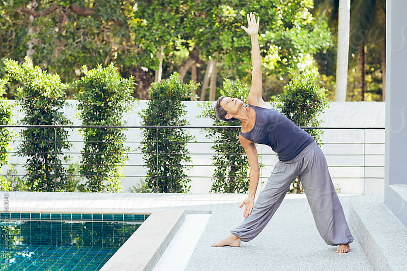 Senior Woman Doing Yoga at Home by Lumina for Stocksy United