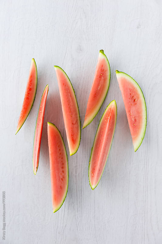 Slices of watermelon in a graphic arrangement by Kirsty Begg for Stocksy United