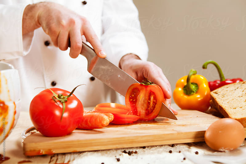 Cutting Tomato by Mosuno for Stocksy United