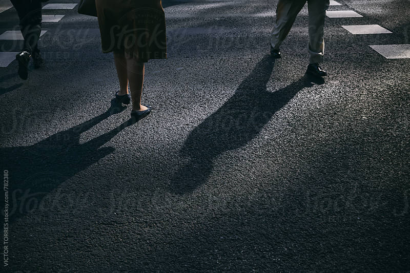 People Crossing the Street by Victor Torres for Stocksy United