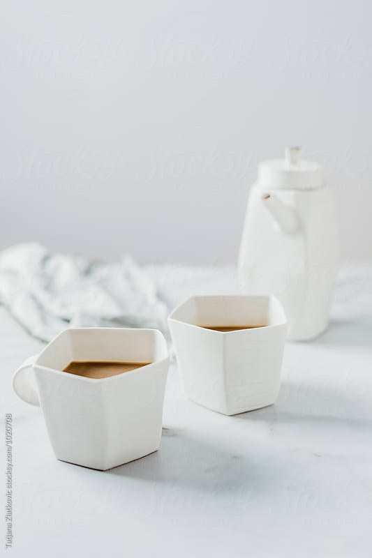 Artistic mugs and teapot by Tatjana Ristanic for Stocksy United
