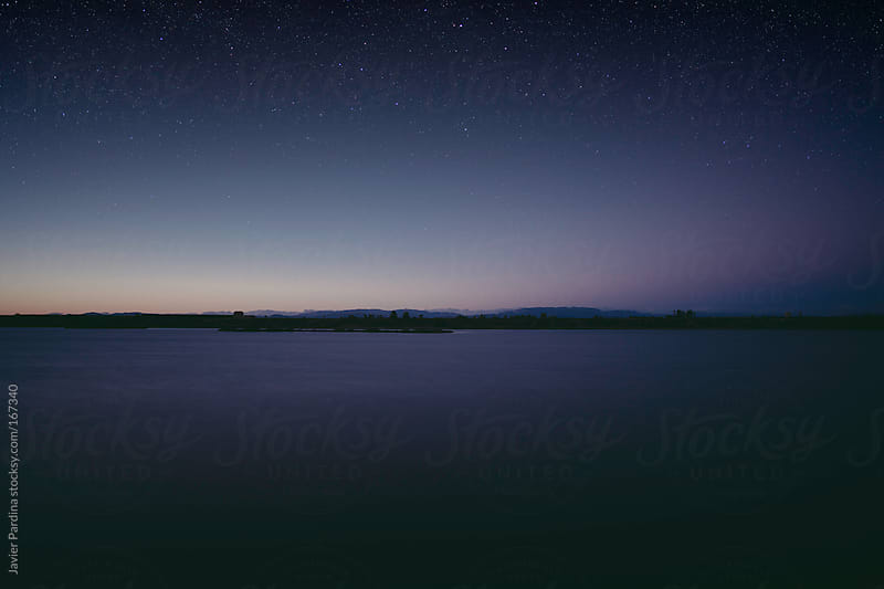 scenery of lake at dusk with stars by Javier Pardina for Stocksy United