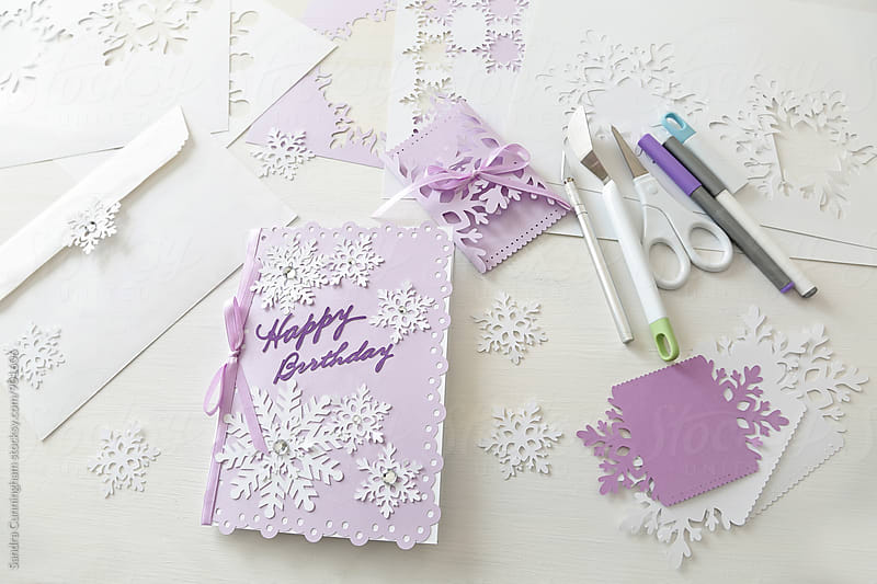 Birthday card made with paper snowflakes by Sandra Cunningham for Stocksy United