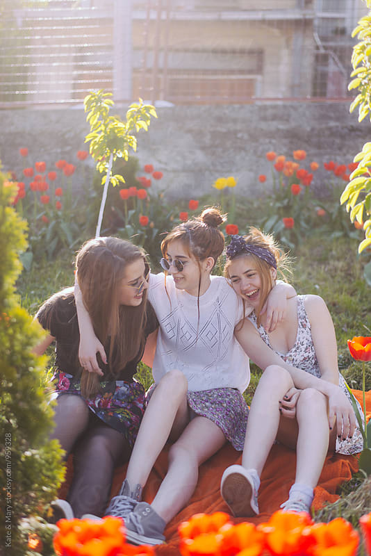 Happy three friends having fun on sunny day by Katarina Simovic for Stocksy United