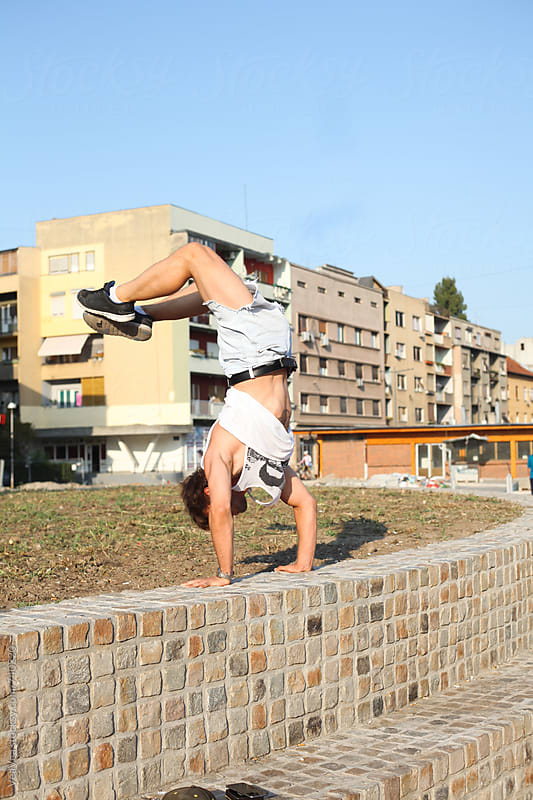 Man doing handstand in the city centre by VeaVea for Stocksy United