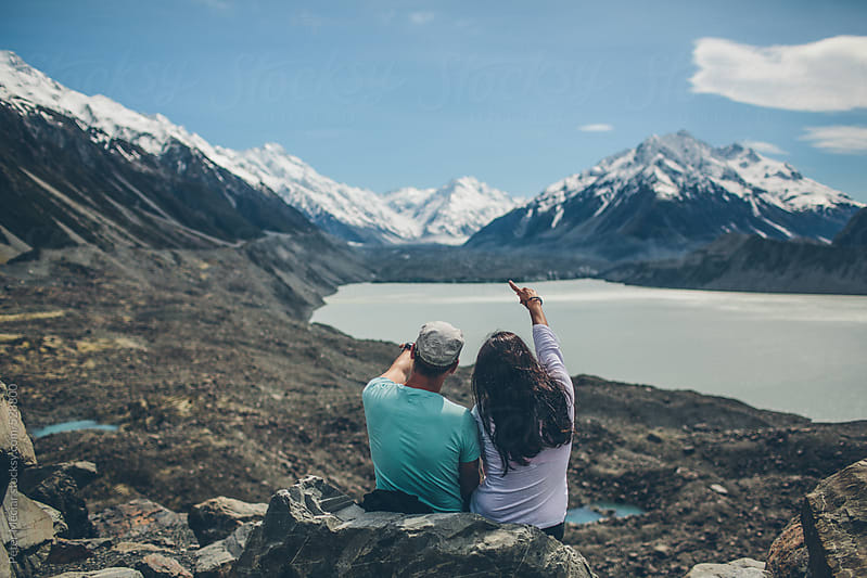 Couple on Mountain - Around New Zealand by Peter Meciar for Stocksy United