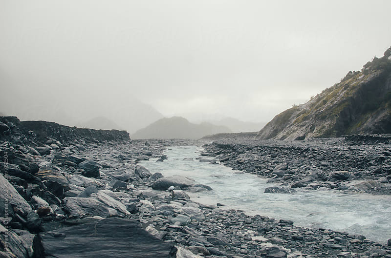 Icy river near Fox Glacier by Dominique Chapman for Stocksy United