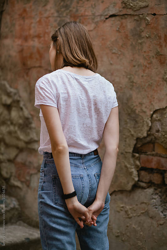 Girl stands with his back to the camera by Sergey Filimonov for Stocksy United
