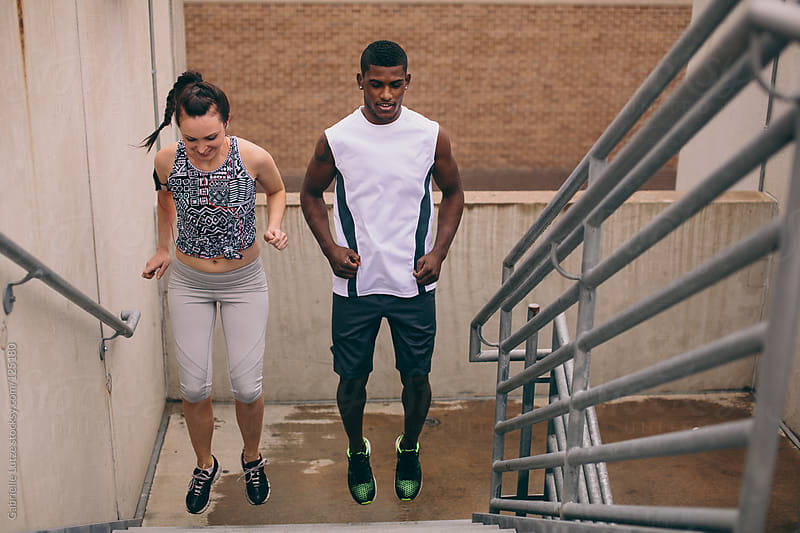 Young Couple Exercising Outside by Gabrielle Lutze for Stocksy United