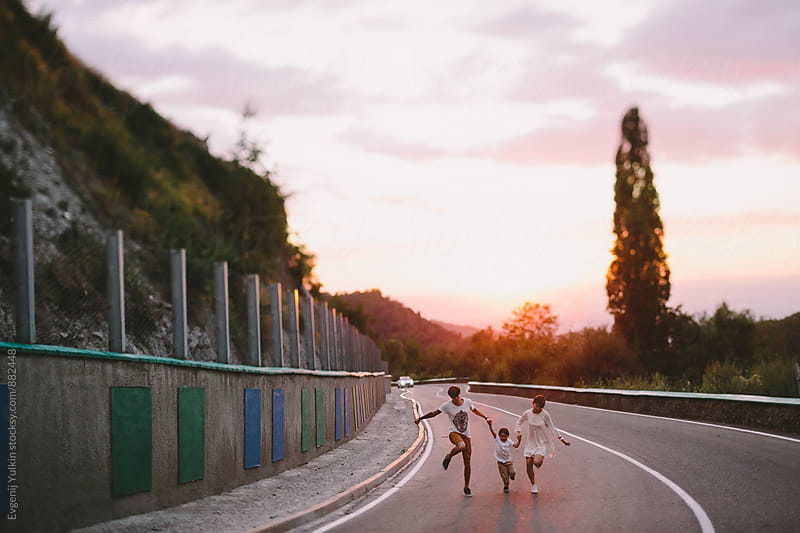 Family running on the road by Evgenij Yulkin for Stocksy United
