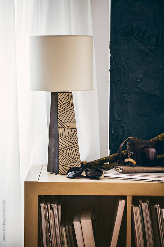 Lamp on a Bookshelf by Lumina for Stocksy United