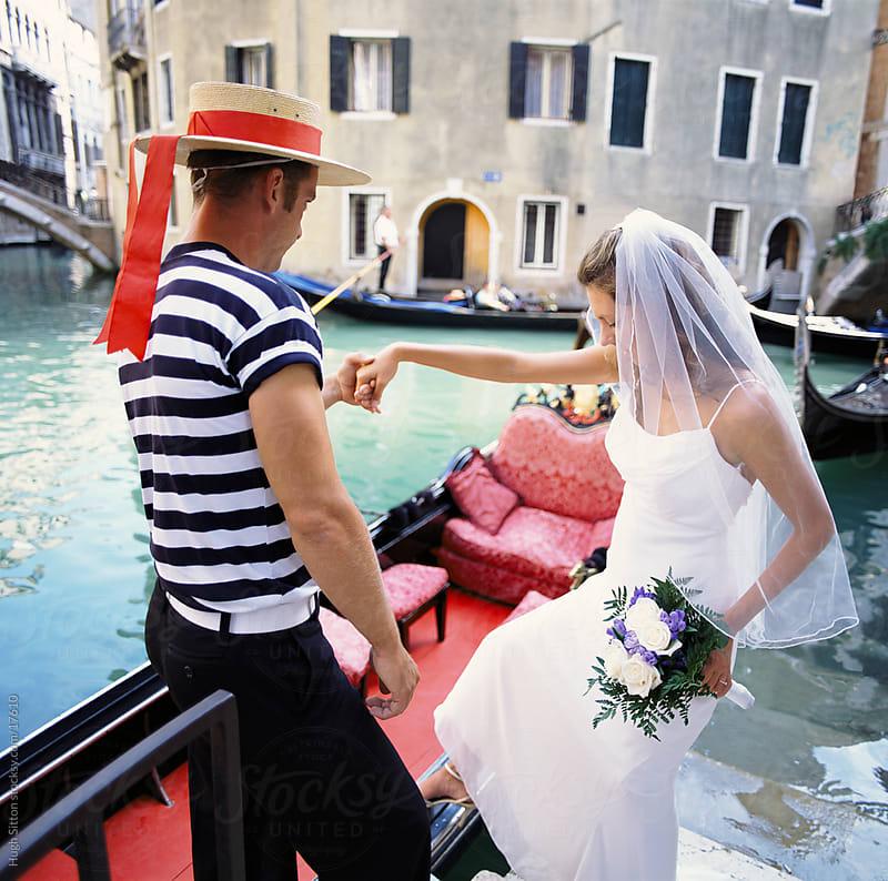 Bride getting into gondola. Venice. Italy.  by Hugh Sitton for Stocksy United