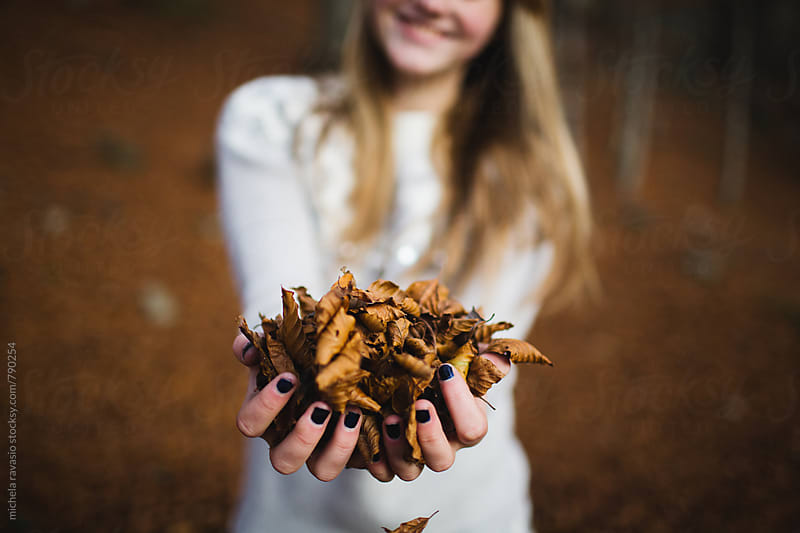 Female hands full of dry leaves by michela ravasio for Stocksy United
