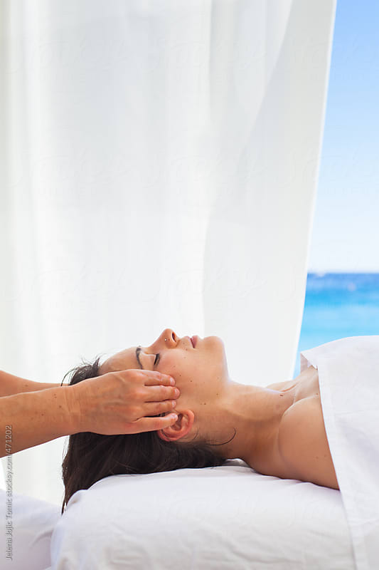 Acupressure treatment at the spa resort by the sea by Jelena Jojic Tomic for Stocksy United