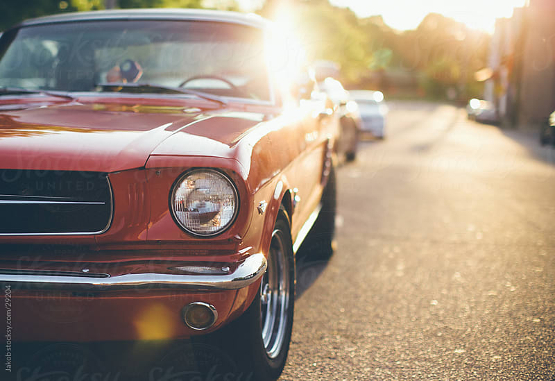 An american muscle car parked on a street during sunset by Jakob for Stocksy United