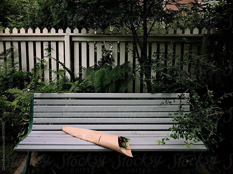 Outdoor bench with bouquet of flowers by Carey Shaw for Stocksy United