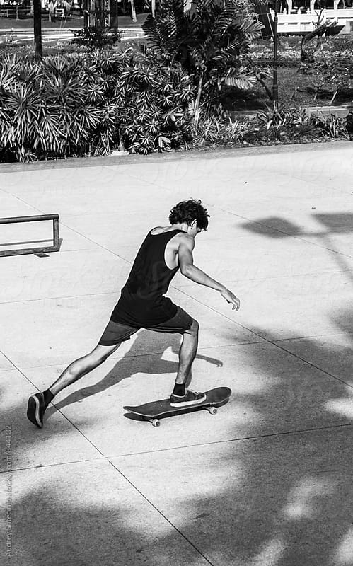 Young skater driving his skateboard on sunny day. by Audrey Shtecinjo for Stocksy United