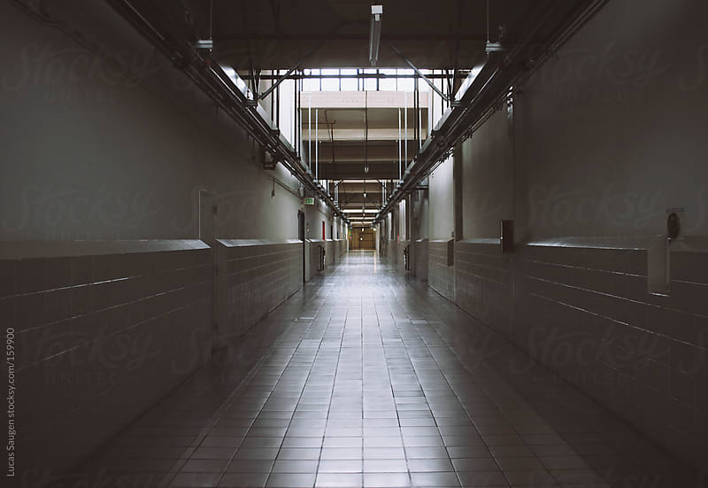 A really long hallway in a commercial space. by Lucas Saugen for Stocksy United