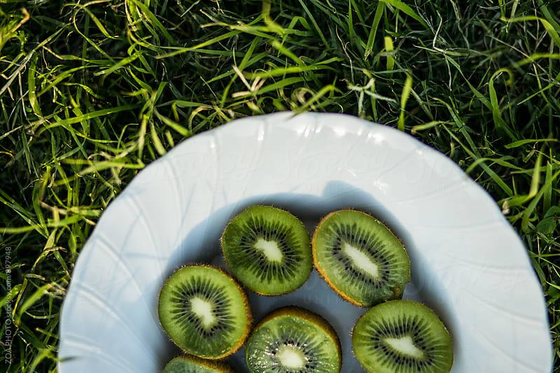 Bowl of kiwifruit  by ZOA PHOTO for Stocksy United