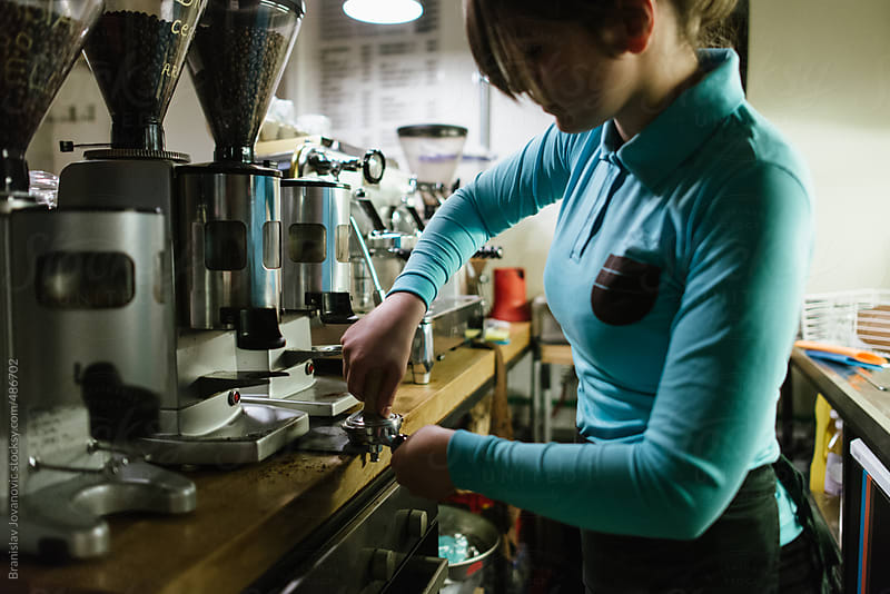 Female barista preparing coffee by Brkati Krokodil for Stocksy United