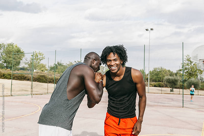Two Black Friends Having Fun in a Basketball Street Court by Victor Torres for Stocksy United