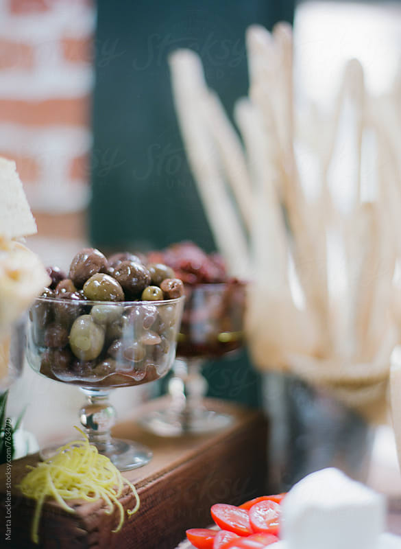 Olive Hor dourves Buffet by Marta Locklear for Stocksy United