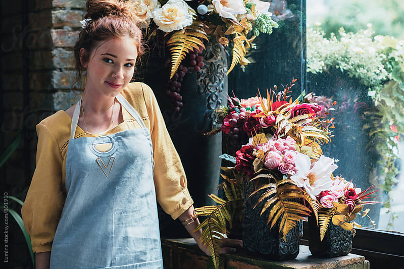 Smiling Florist in a Flower Shop by Lumina for Stocksy United