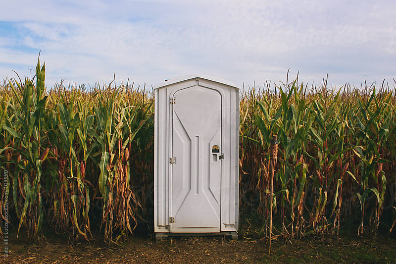 Outhouse in Corn Maze by Gabrielle Lutze for Stocksy United