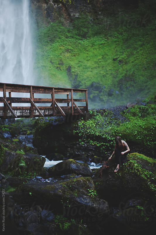 Woman by Creek Bridge by Kevin Russ for Stocksy United