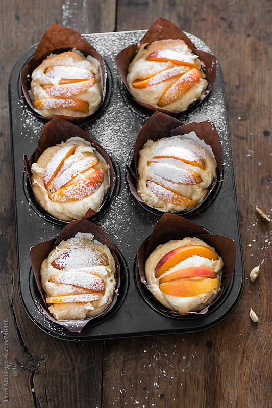 apricot and cardamom cupcakes by Laura Adani for Stocksy United
