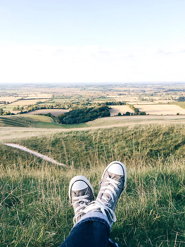 View of Oxfordshire with shoes in foreground by Kirstin Mckee for Stocksy United