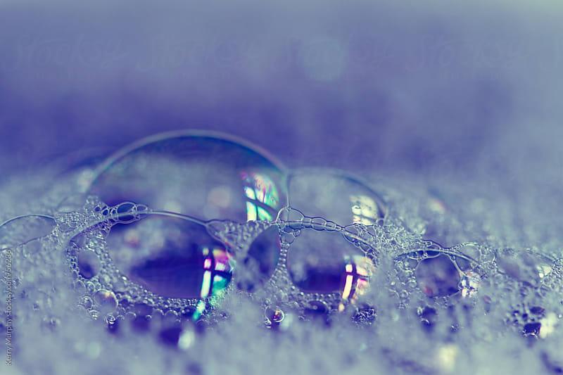 Macro of soap bubbles on purple by Kerry Murphy for Stocksy United