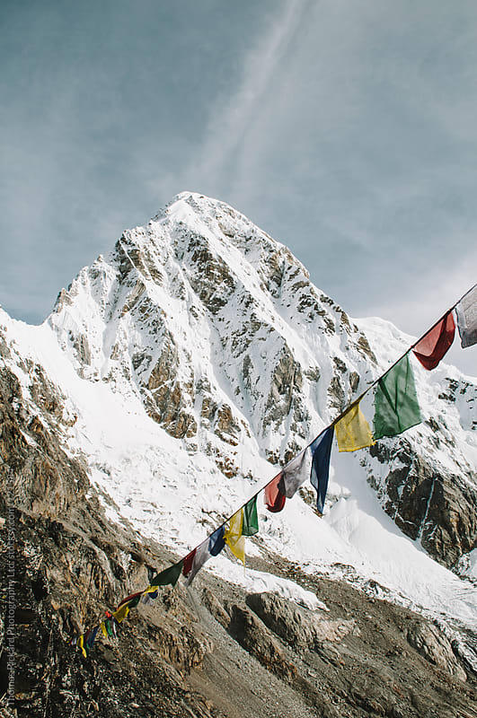 Prayer flags and mountain, Everest Region, Sagarmatha National Park, Nepal. by Thomas Pickard for Stocksy United