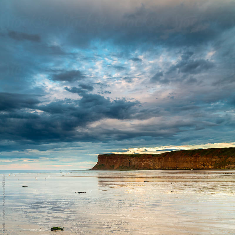 Clouds over a cliff at sunset by Marilar Irastorza for Stocksy United