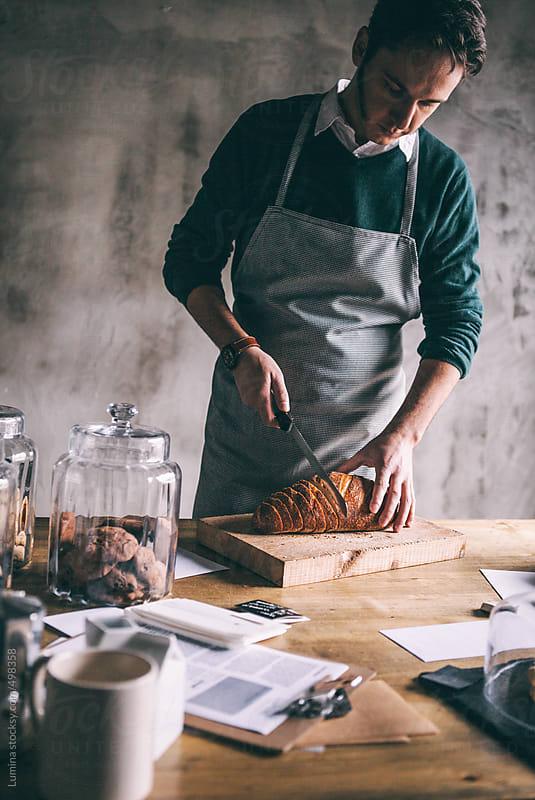 Baker Slicing Bread by Lumina for Stocksy United