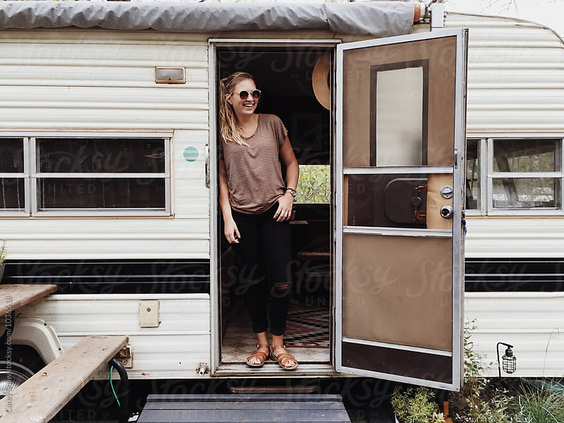 Stylish woman and vintage trailer by Carey Shaw for Stocksy United