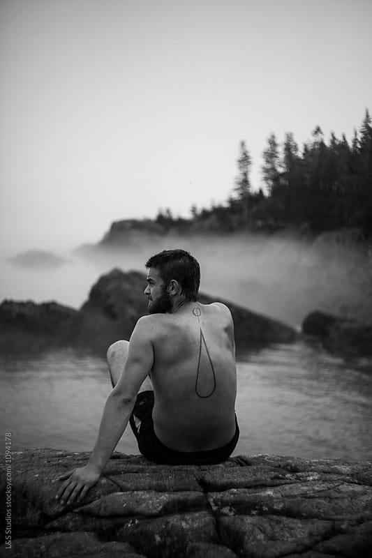 Hiker on the coast by L&S Studios for Stocksy United