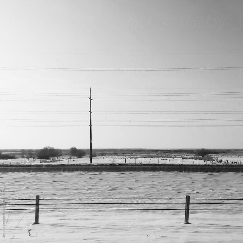 Black and white power lines in the horizon by Heather Perera for Stocksy United