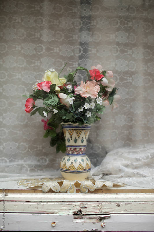 Fake flowers in  vase by Marcel for Stocksy United