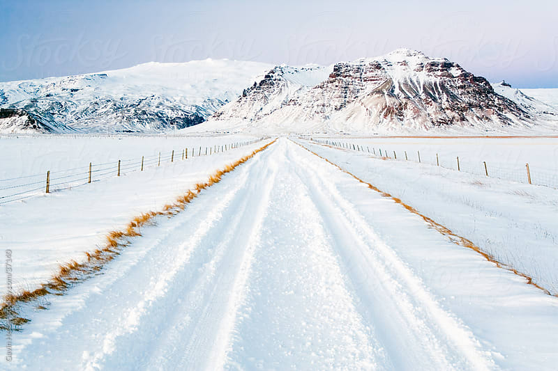 Iceland, road and mountains in winter by Gavin Hellier for Stocksy United