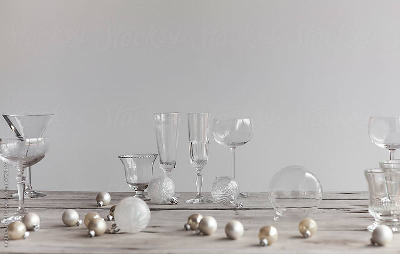 Variety of glassware and christmas decorations on table by Nadine Greeff for Stocksy United