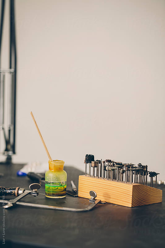 Still life shot of tools used for artisan jewelry making by Lior + Lone for Stocksy United