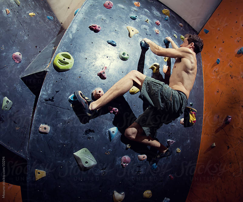Young Man Free Climbing Artificial Rock by Mosuno for Stocksy United