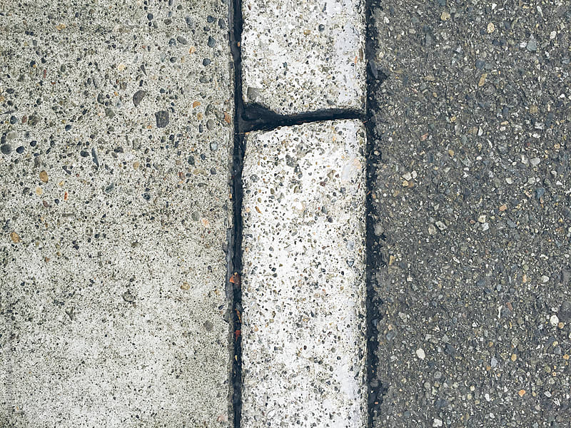 Close up of curb, sidewalk and urban street by Paul Edmondson for Stocksy United