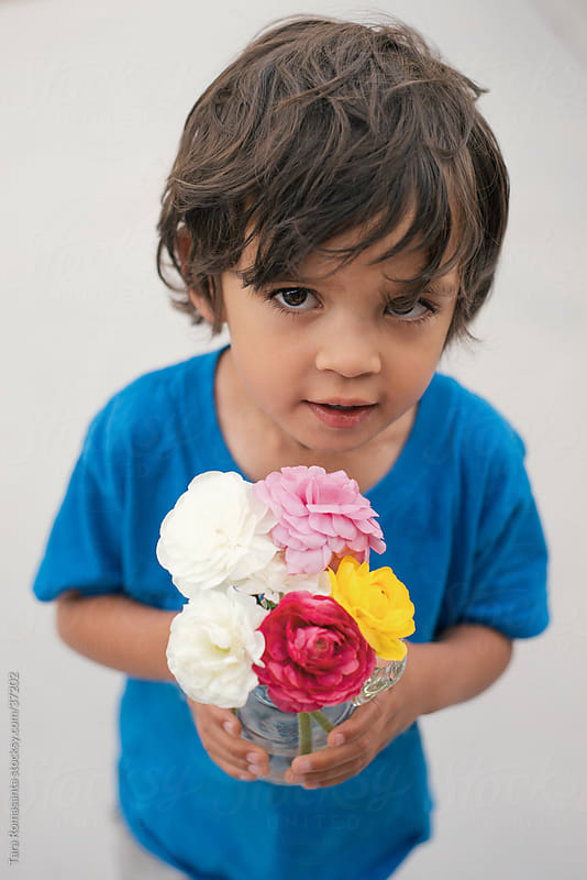boy with bouquet: for you, mommy by Tara Romasanta for Stocksy United