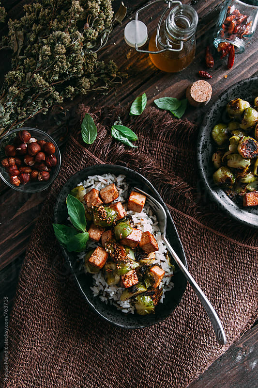 Wild rice with roasted Brussels Sprouts and crispy tofu with sesame by Nataša Mandić for Stocksy United