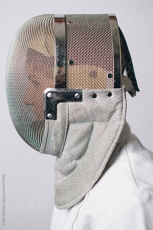 Sideview of professional fencing athlete in mask by Danil Nevsky for Stocksy United