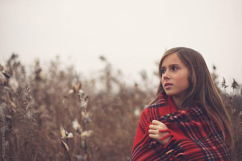 Girl In A Red Blanket by ALICIA BOCK for Stocksy United