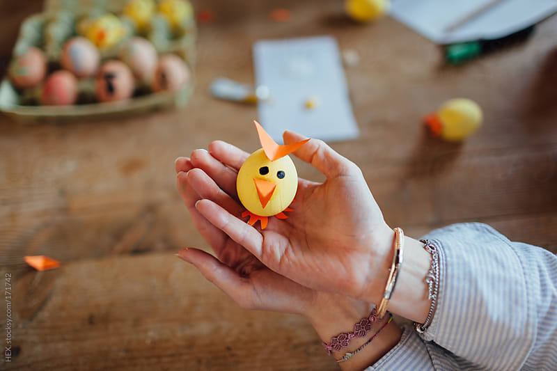 Friends Creating Easter Egg Chick  by HEX. for Stocksy United