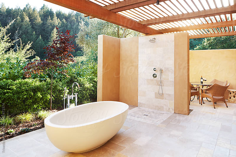 Luxury resort room with outdoor bathtub in California  by Trinette Reed for Stocksy United